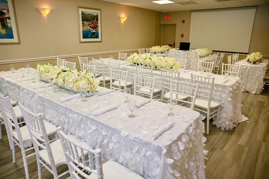 event room setup with rows of tables with chairs