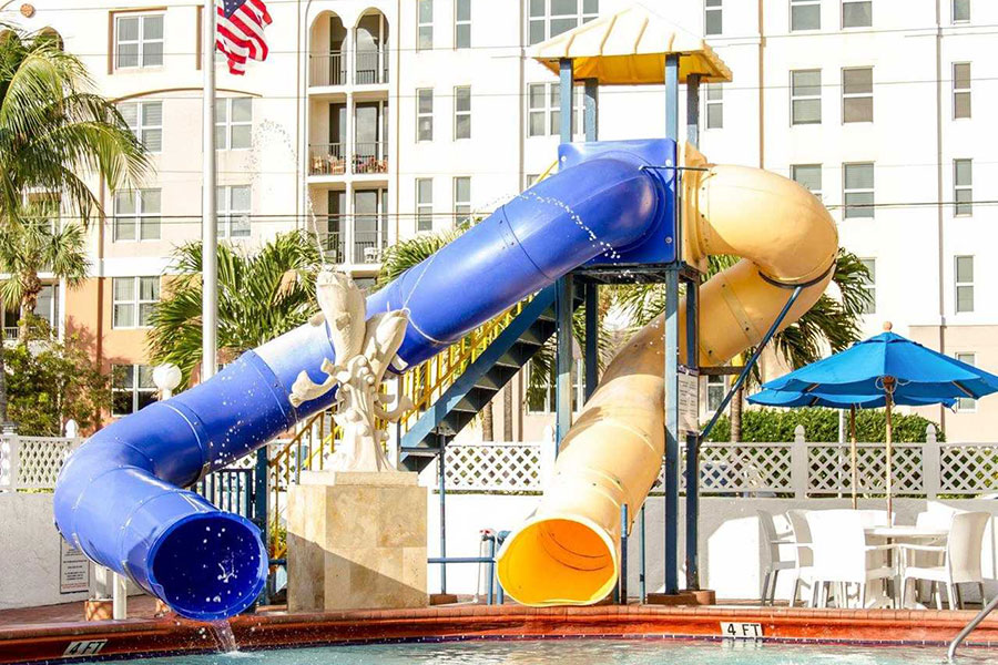 outdoor pool area waterslides and fountain